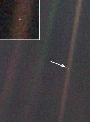 "The ""Pale Blue Dot"" photo of the Earth, taken from NASA's Voyager 1 spacecraft."
